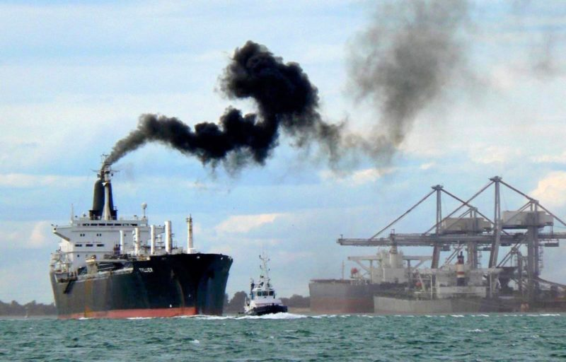 Maritime ship spewing dark emissions