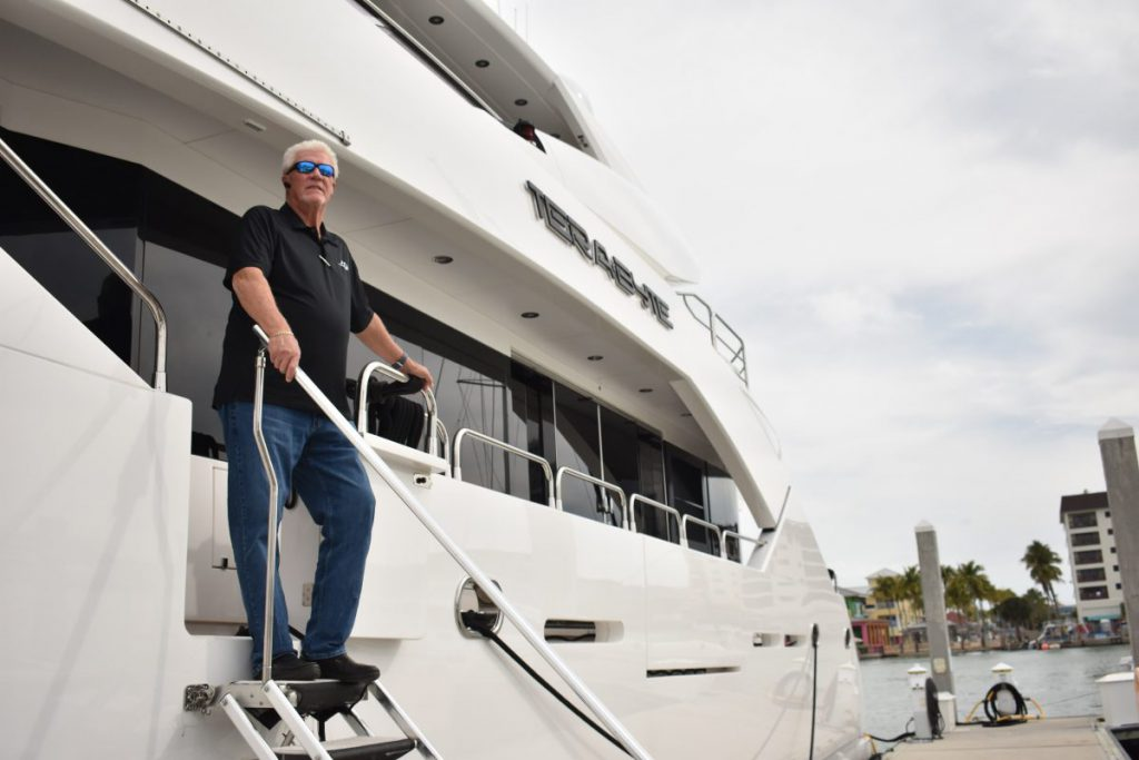 Bill Miller, AXI's Director of Marine Fueling Solutions Worldwide, posing on the mega-yacht Terabyte